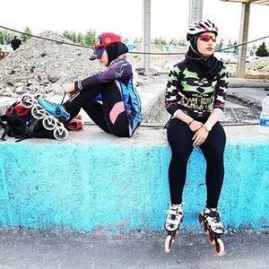Women getting ready to roller skate at Azadi Sports Complex, Tehran, Iran.