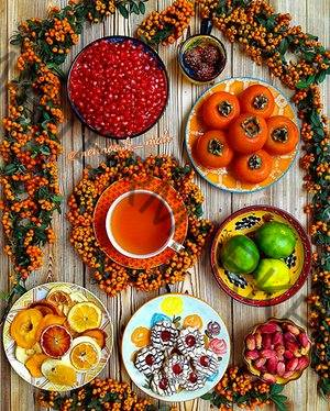 Aerial view of Iranian food, stews and vegetable dishes, laid out on a table.