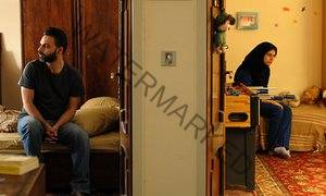 Actors Peyman Moaadi (left) and Sarina Farhadi in a scene from director Asghar Farhadi's A Separation.