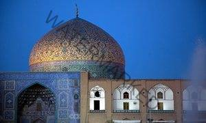 The dome of Sheikh Lotfollah mosque, Isfahan, Iran, seen at night.
