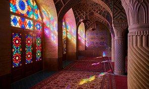 Light floods in through stained glass windows at Nasir-al-Molk mosque, Shiraz, Iran.