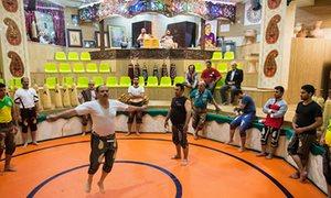 Wrestlers perform Zurkhaneh.