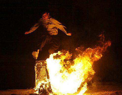 Jumping over fire at Chaharshanbeh Soori