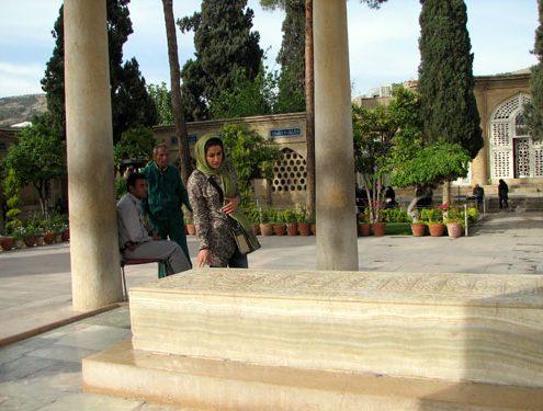 Iranian woman praying at Hafez tomb