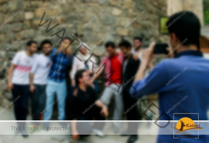 """The Iranians that we met on the """"Treasures of Persia"""" trip were always eager to have their picture taken with us. Same goes for this group of guys who ran into us at St. Stephanos Church."""